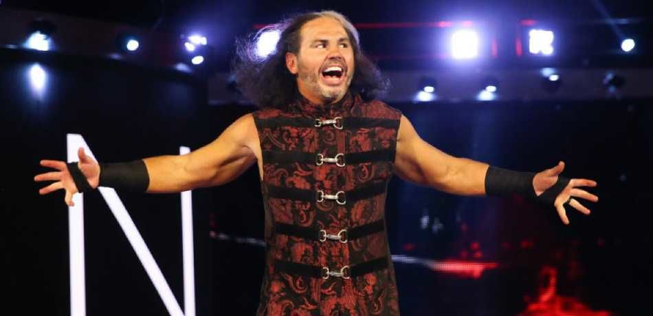 Matt Hardy strikes a pose in front of some spotlights.