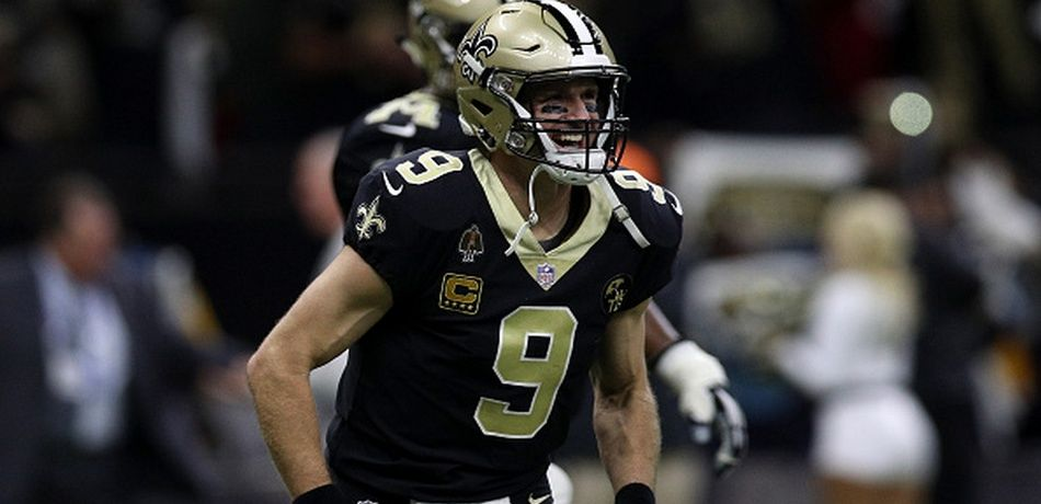 Drew Brees #9 of the New Orleans Saints reacts against the Atlanta Falcons at the Mercedes-Benz Superdome