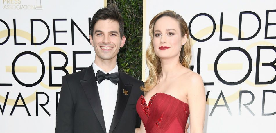 Brie Larson and Alex Greenwald attend the Golden Globes.