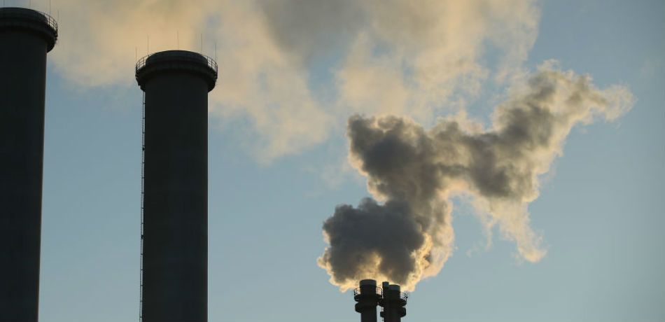 Exhaust rises from the smokestack of a natural gas-burning power and heating plant