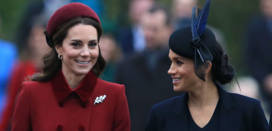 Kate Middleton and Meghan Markle chat as they arrive at Christmas Day church service.
