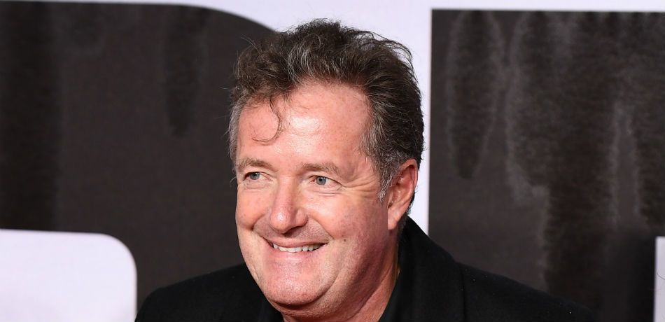Piers Morgan smiles from the red carpet.