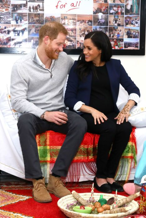 Prince Harry and Meghan sit together in Morocco