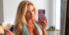 Abby Dowse poses for a mirror selfie in blue lingerie.