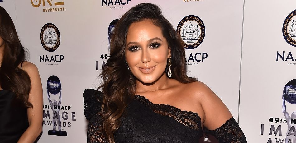 Adrienne Bailon Looks Years Younger Than Her Age In A Neon Bikini At The Beach