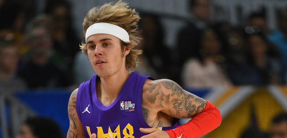 Canadian singer and songwriter Justin Bieber plays during the 2018 NBA All-Star Game Celebrity Game