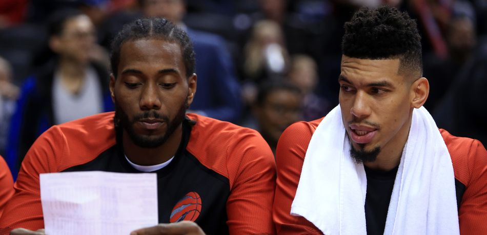 Kawhi Leonard #2 and Danny Green #14 of the Toronto Raptors sit on the bench reading the half time stats during the second half of an NBA preseason game against Melbourne United at Scotiabank Arena on October 5, 2018 in Toronto, Canada.