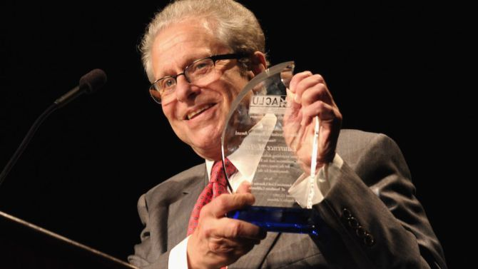 Laurence Tribe holds up an ACLU award.