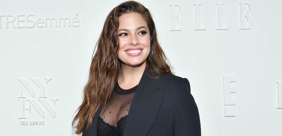 Ashley Graham poses for a photo at an 'Elle' event.