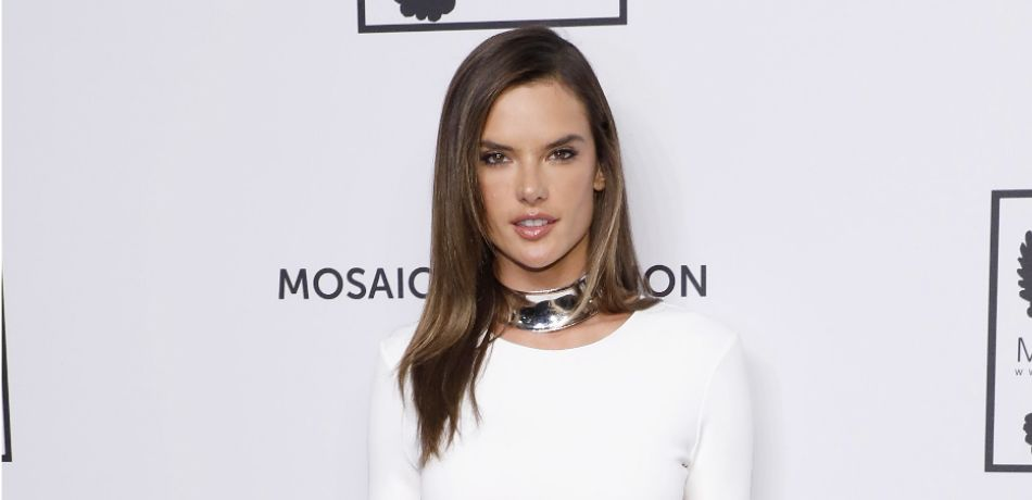 Alessandra Ambrosio Lays On The Sand In A Tiny Black Bikini In Hot New Photo