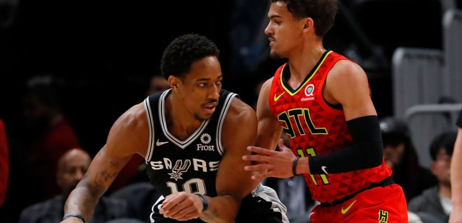 DeMar DeRozan #10 of the San Antonio Spurs drives against Trae Young #11 of the Atlanta Hawks at State Farm Arena on March 06, 2019 in Atlanta, Georgia.