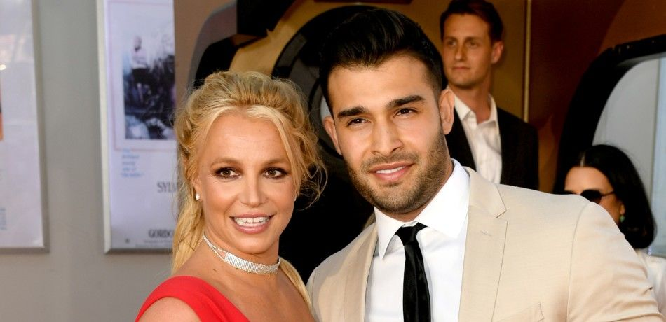 Britney Spears and Sam Asghari pose for a photo in Hollywood.