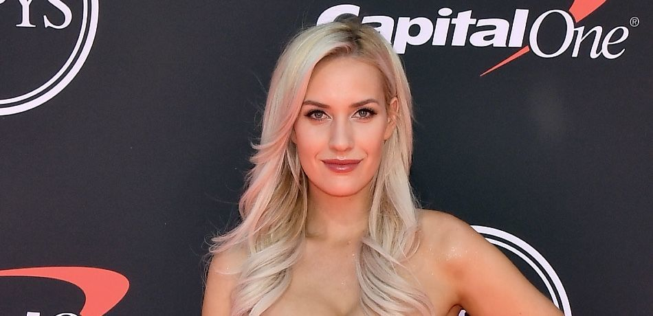 Paige Spiranac poses for a photo on the red carpet.