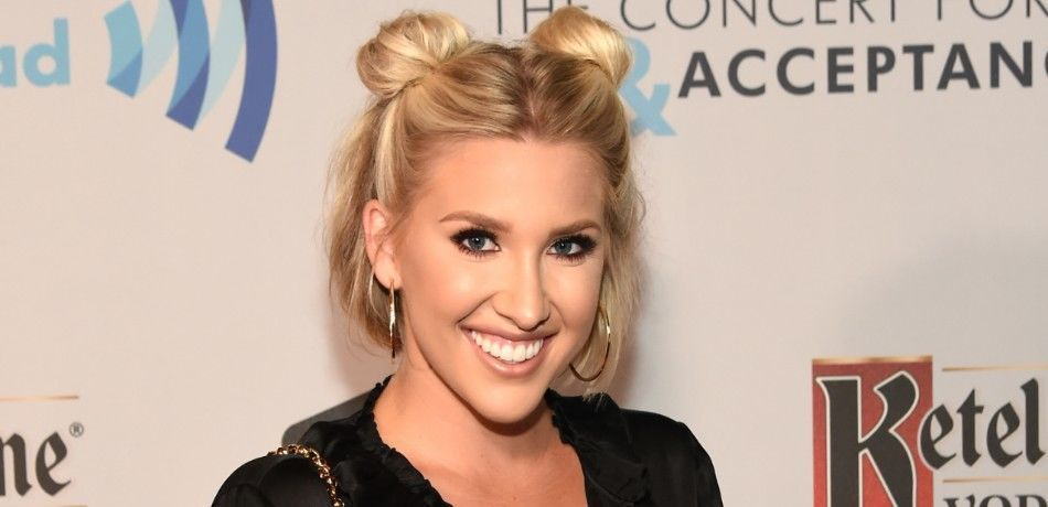 Savannah Chrisley poses for a photo on the red carpet.