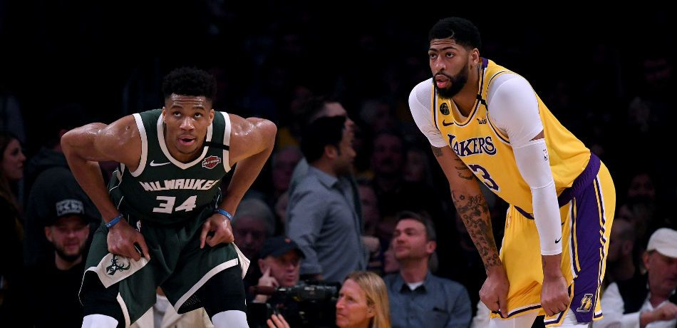 Giannis Antetokounmpo #34 of the Milwaukee Bucks and Anthony Davis #3 of the Los Angeles Lakers wait during the third quarter at Staples Center on March 06, 2020 in Los Angeles, California.
